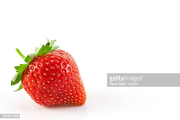 close-up of strawberry against white background - strawberry stock pictures, royalty-free photos & images