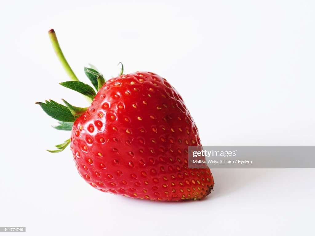 Close-Up Of Strawberry Against White Background : Stock Photo