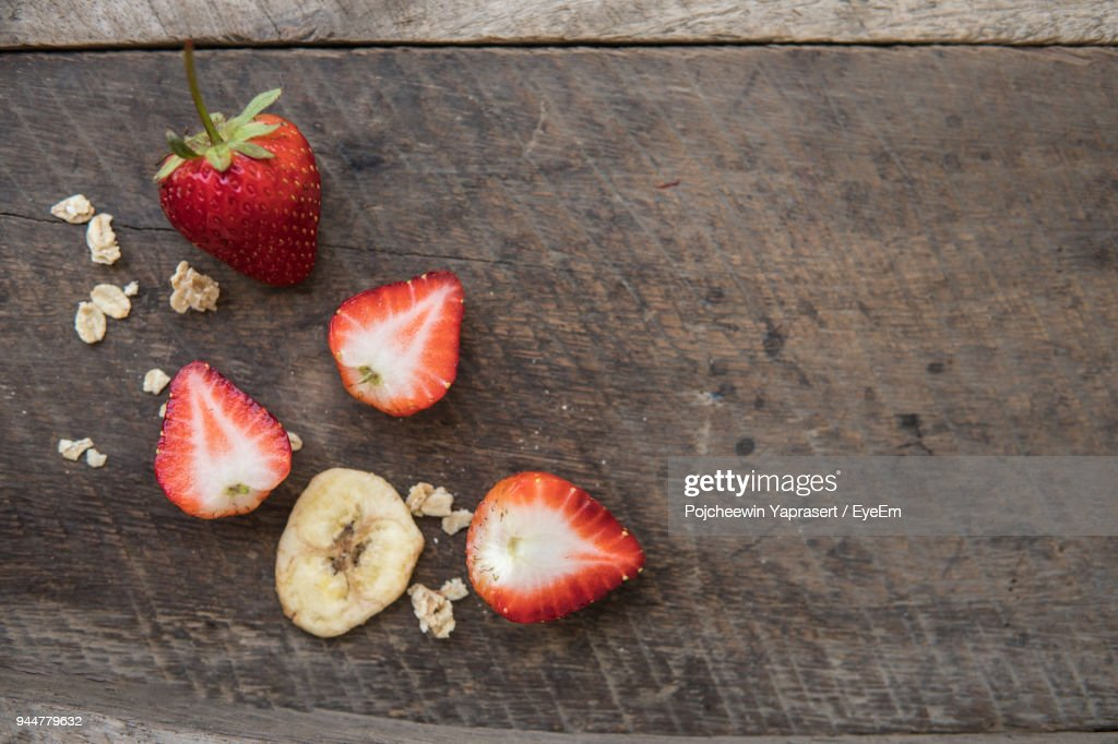 Close-Up Of Strawberry And Nut In Glass On Table : Stock Photo