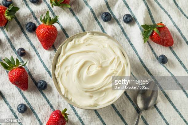 close-up of strawberry and yogurt on table - mascarpone cheese stock pictures, royalty-free photos & images