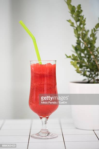 Close-Up Of Strawberry Drink In Glass On Table