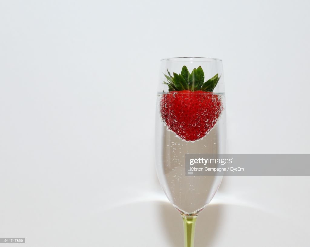 Closeup Of Strawberry In Drink Against White Background ...