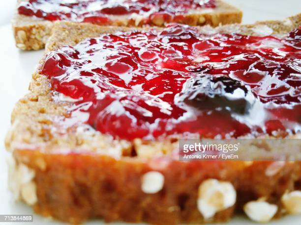Close-Up Of Strawberry Jam On Bread