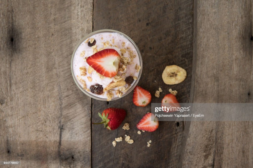 Close-Up Of Strawberry Milkshake In Glass On Table : Stock Photo