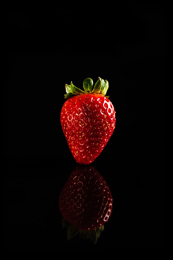 Close-Up Of Strawberry Over Black Background - gettyimageskorea