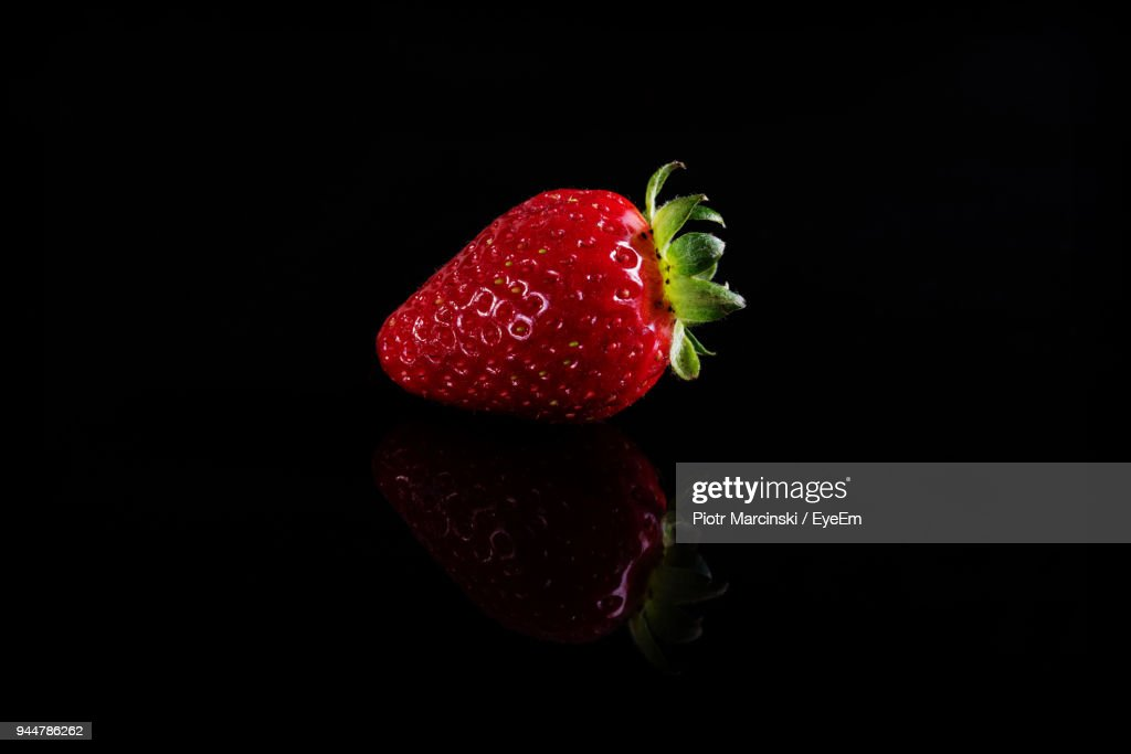 Close-Up Of Strawberry Over Black Background : Stock Photo