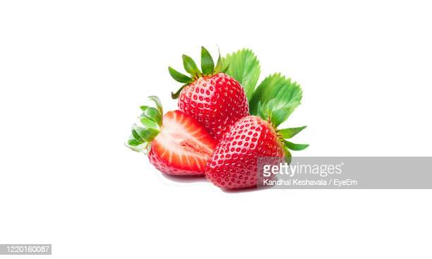 close-up of strawberry over white background - strawberry stock pictures, royalty-free photos & images