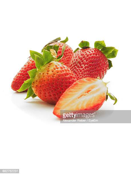 Close-Up Of Strawberry Over White Background