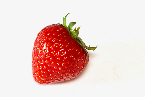 Close-Up Of Strawberry Over White Background - gettyimageskorea