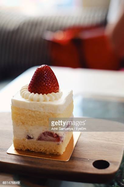 Close-Up Of Strawberry Shortcake Served On Table