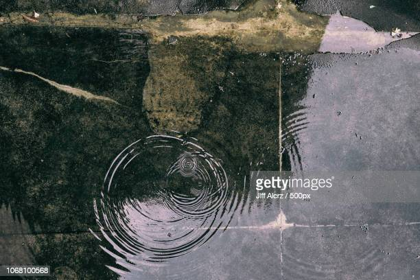 close-up of street puddle - puddle stock pictures, royalty-free photos & images
