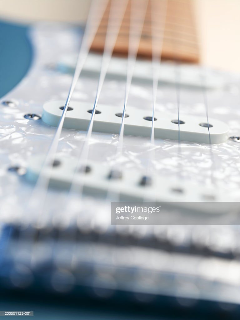 Guitar Pickups Too Close To Strings : closeup of strings and pickups on electric guitar high res stock photo getty images ~ Russianpoet.info Haus und Dekorationen