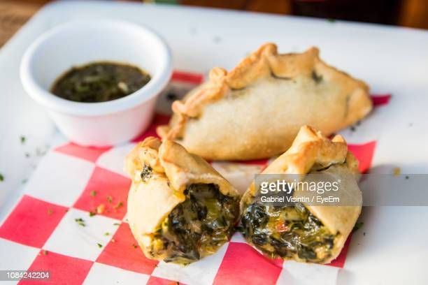 close-up of stuffed food and dip in tray - empanada stock pictures, royalty-free photos & images