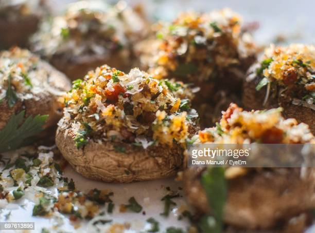 close-up of stuffed portobello mushrooms served in plate - edible mushroom stock pictures, royalty-free photos & images