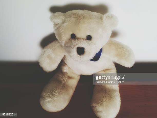 Close-Up Of Stuffed Toy Against White Wall