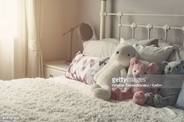 close-up of stuffed toy on bed at home - teddy bear stock pictures, royalty-free photos & images