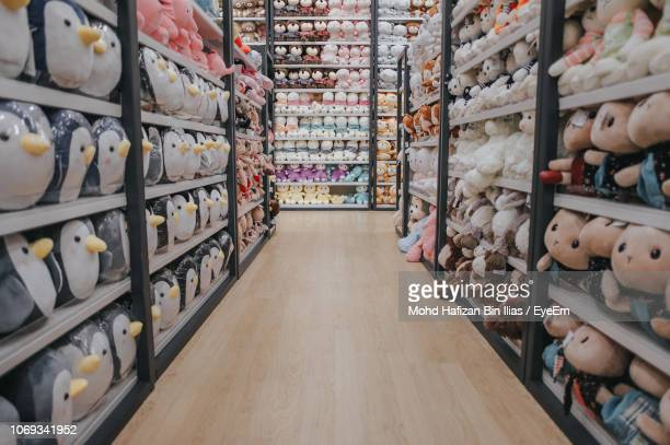 close-up of stuffed toys for sale in store - aisle stock pictures, royalty-free photos & images