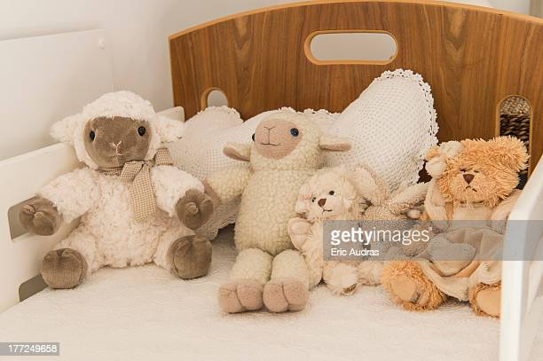 Close-up of stuffed toys on a bed