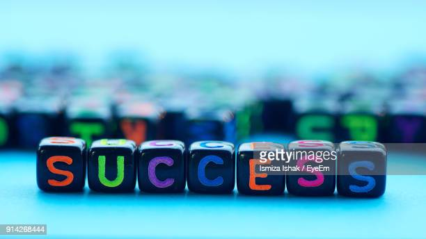 Close-Up Of Success Text On Blocks