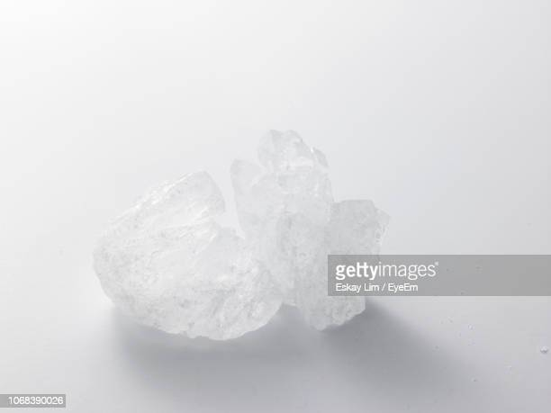 Close-Up Of Sugar Over White Background