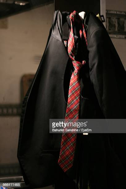 close-up of suit and necktie on backstage - coat stock pictures, royalty-free photos & images