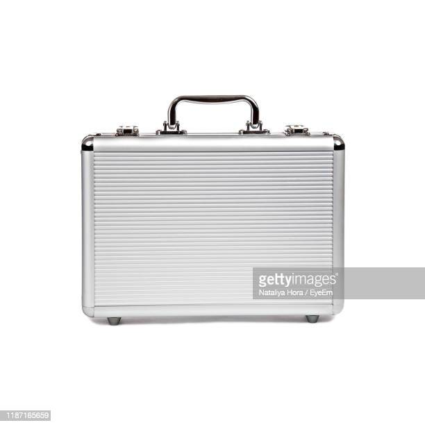 close-up of suitcase over white background - briefcase stock pictures, royalty-free photos & images