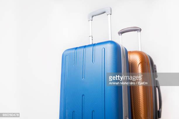 close-up of suitcases against white background - luggage stock pictures, royalty-free photos & images