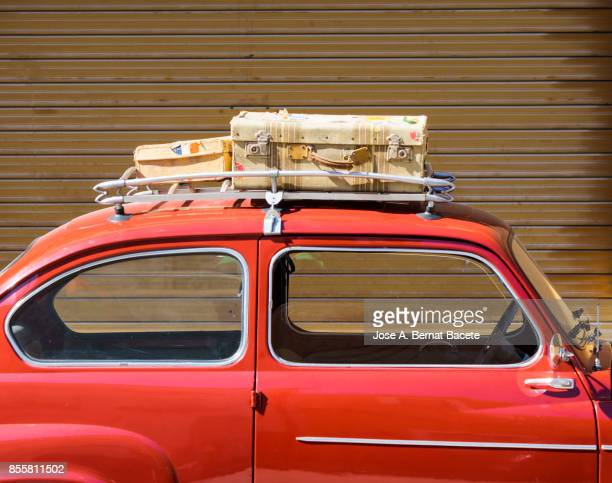 close-up of suitcases on car trunk, ancient car loaded with ancient suitcases of leather. valencia, spain - luggage rack stock photos and pictures