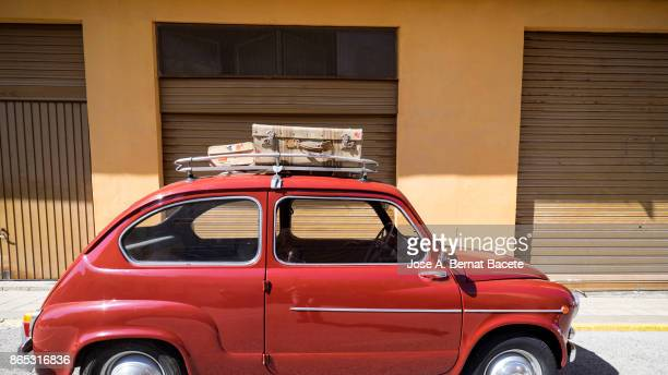 close-up of suitcases on car trunk, ancient car loaded with ancient suitcases of leather. valencia, spain - wear red day stock photos and pictures