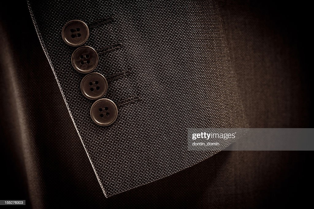 Close-up of suit's sleeve and buttons in brown colour : Stock Photo