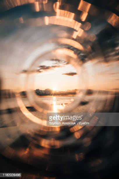 close-up of sun seen through glass bottles - photographed through window stock pictures, royalty-free photos & images