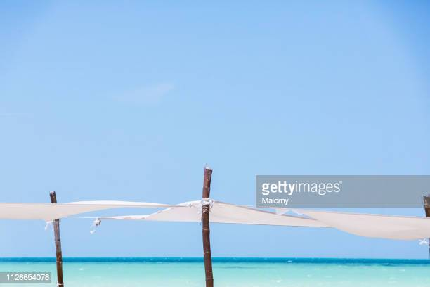 close-up of sun shades at the beach. - holbox island fotografías e imágenes de stock