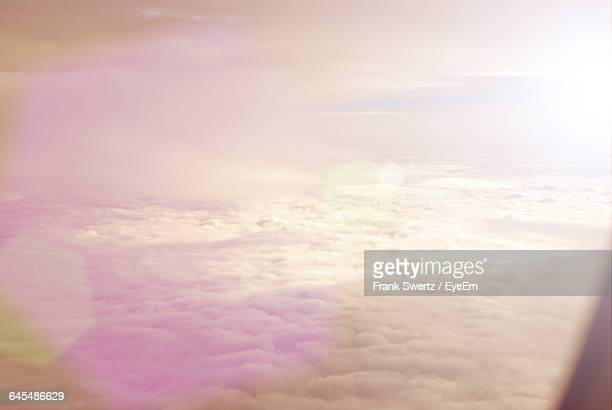 close-up of sun shining through clouds - frank swertz stock pictures, royalty-free photos & images
