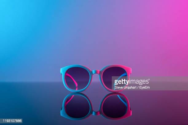 close-up of sunglasses against black background - still life stock pictures, royalty-free photos & images