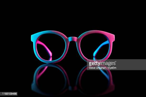 close-up of sunglasses against black background - spectacles stock pictures, royalty-free photos & images