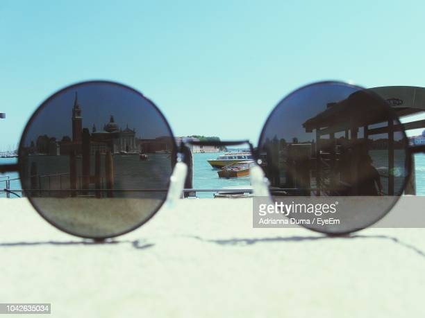 Close-Up Of Sunglasses Against Clear Sky