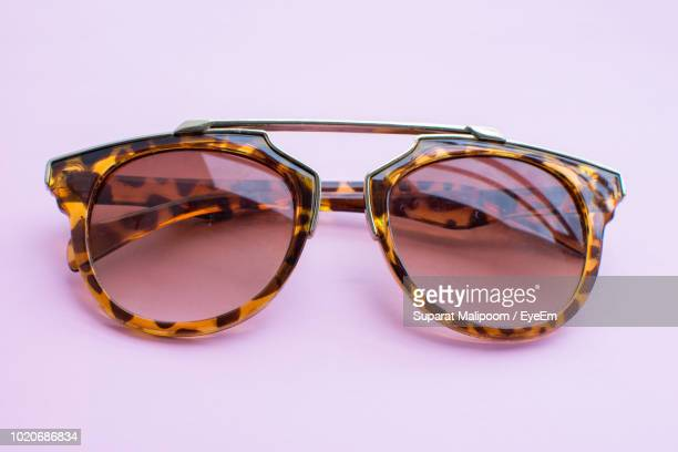 Close-Up Of Sunglasses Against Pink Background