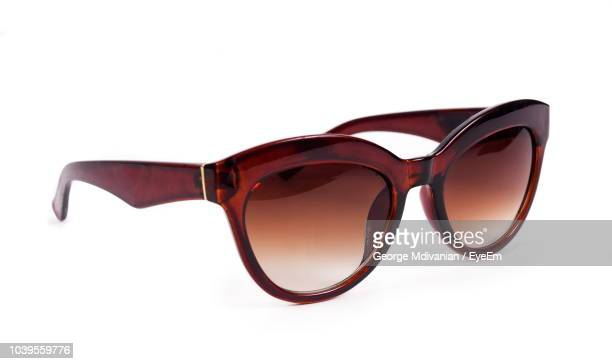 close-up of sunglasses against white background - sunglasses stock pictures, royalty-free photos & images