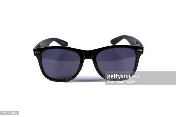 6858bf8c4552d0 Close-Up Of Sunglasses Against White Background