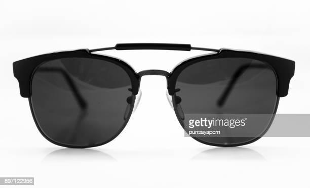 close-up of sunglasses against white background - lunettes de soleil photos et images de collection