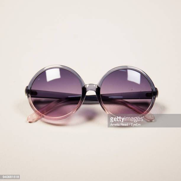 close-up of sunglasses against white background - still life not people stock photos and pictures