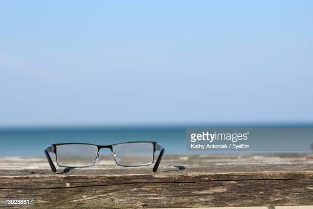 Close-Up Of Sunglasses On Beach Against Clear Sky