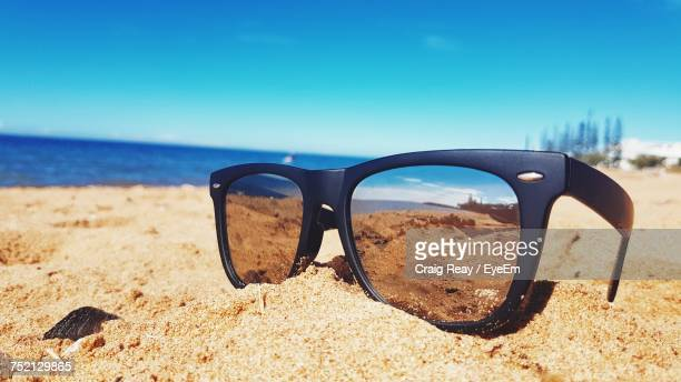 Close-Up Of Sunglasses On Beach