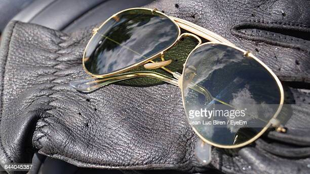 Close-Up Of Sunglasses On Gloves