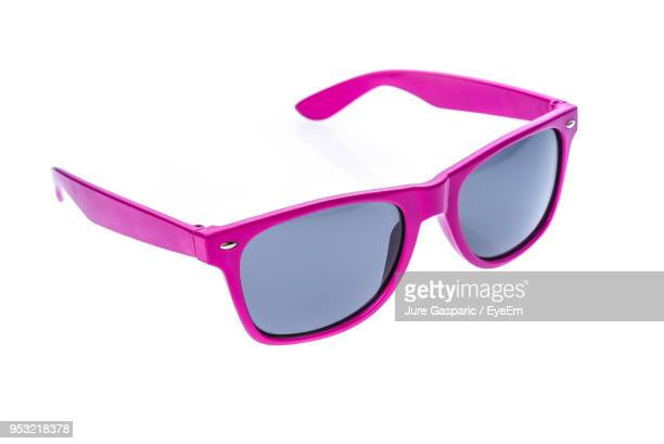 close-up of sunglasses on white background - sunglasses stock pictures, royalty-free photos & images