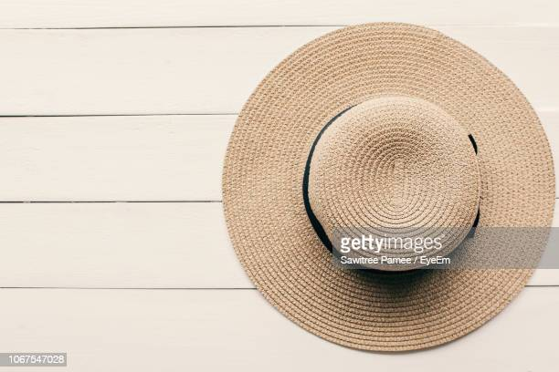 close-up of sunhat on table - hat stock pictures, royalty-free photos & images