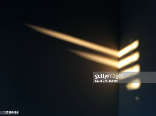 close-up of sunlight falling on wall in darkroom - darkroom stock pictures, royalty-free photos & images
