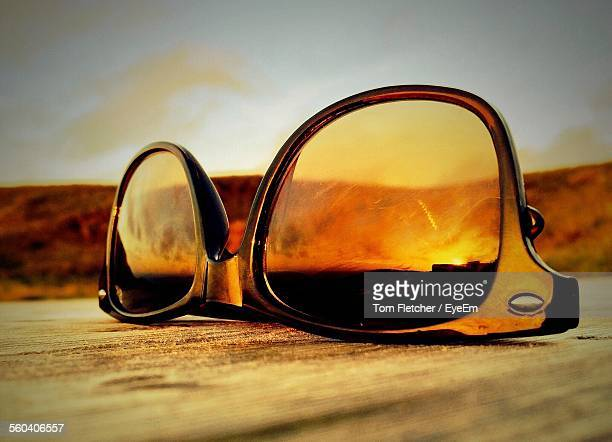 Close-Up Of Sunlight Reflecting On Upside Down Sunglasses