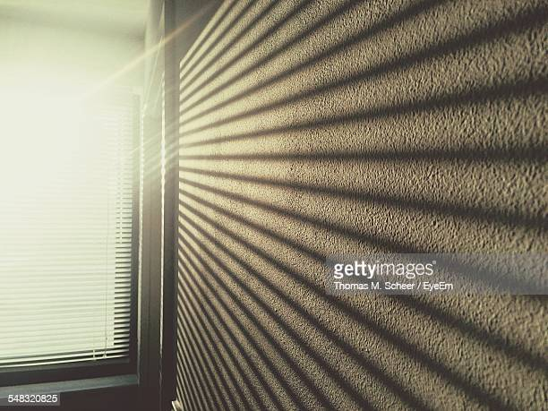 Close-Up Of Sunrays On Wall Through The Window