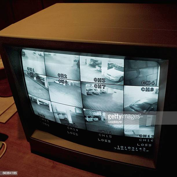 close-up of surveillance monitor showing split screen of different views